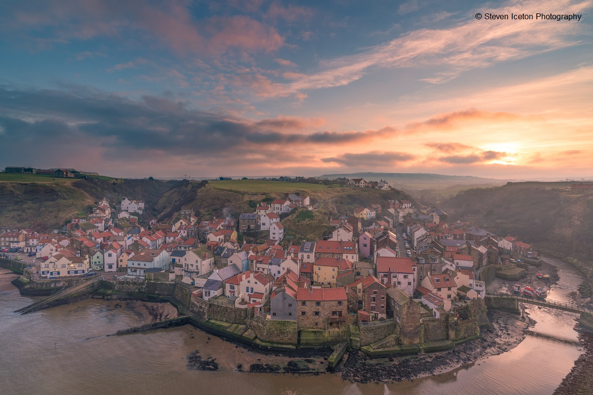 A misty sunset over Staithes